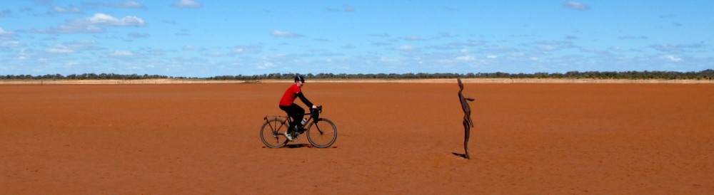 Inspecting Antony Gormley works at Lake Ballard